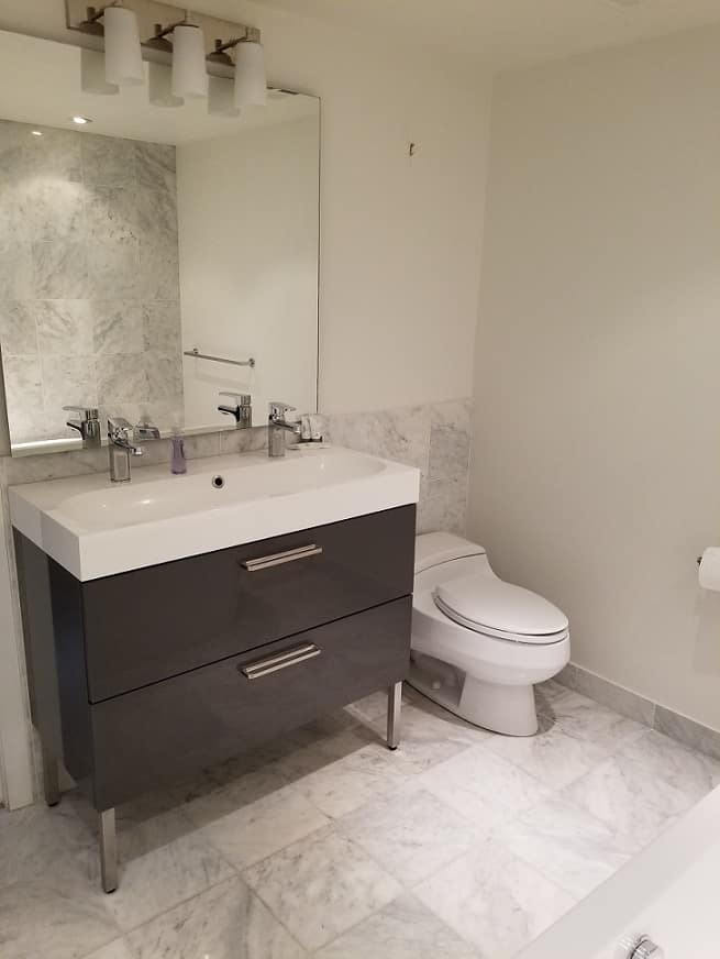 dual sink, stainless faucets - High End Finishes Yaletown Condo - Bathroom Renovation